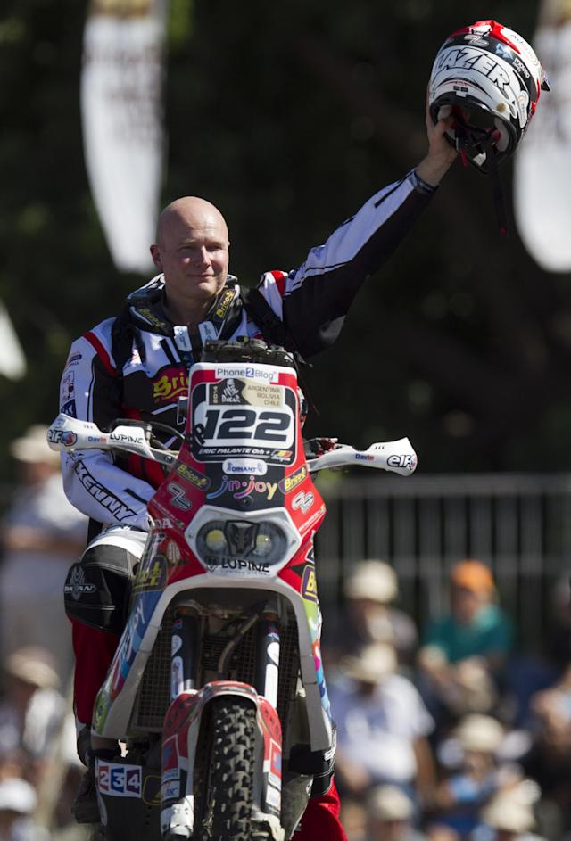 In this Jan. 4, 2014 photo, Belgium's Eric Palante waves from the podium ramp during the symbolic start of the 2014 Argentina-Bolivia-Chile Dakar Rally in Rosario, Argentina. According to a statement from Dakar organizers, Palante's body was found on the morning of Jan. 10, 2014 along the route of the Dakar Rally between Chilecito and San Miguel de Tucuman, Argentina. (AP Photo/Eduardo Di Baia)