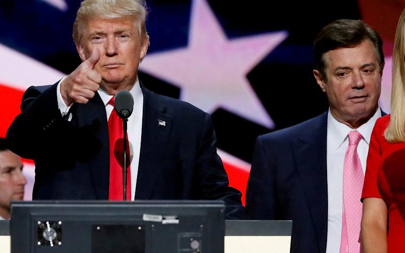 Then-Republican presidential nominee Donald Trump gives a thumbs up as his campaign manager Paul Manafort looks on - REUTERS