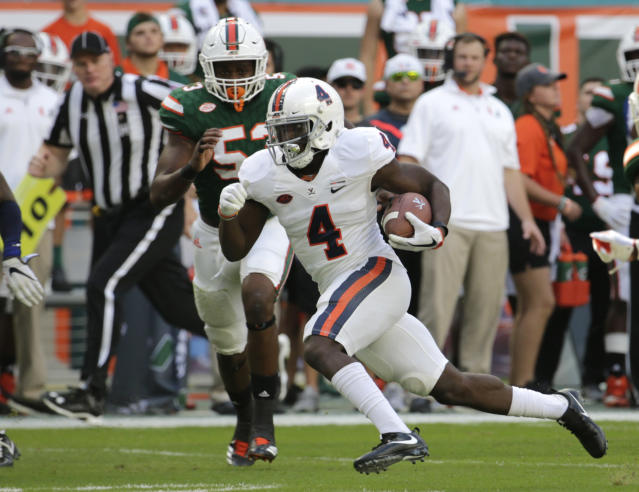 FILE - In this Nov. 18, 2017, file photo, Virginia running back Olamide Zaccheaus (4) runs during the first half of an NCAA college football game against Miami, in Miami Gardens, Fla. Offensive coordinator Robert Anae and his staff have a huge job ahead this summer. With one of the more dynamic offensive weapons on their roster in senior wide receiver Olaimde Zaccheaus, they need to find a way to get him the ball in open spaces. (AP Photo/Lynne Sladky, File)