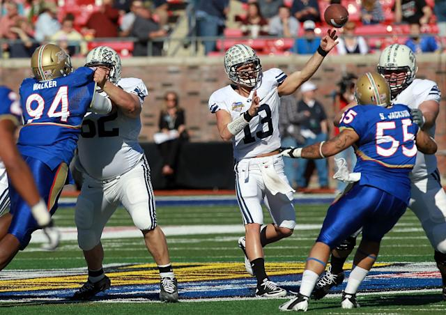 DALLAS, TX - DECEMBER 30: Riley Nelson #13 of the Brigham Young Cougars throws against the Brigham Young Cougars during the Bell Helicopter Armed Forces Bowl at Gerald J. Ford Stadium on December 30, 2011 in Dallas, Texas. (Photo by Ronald Martinez/Getty Images)