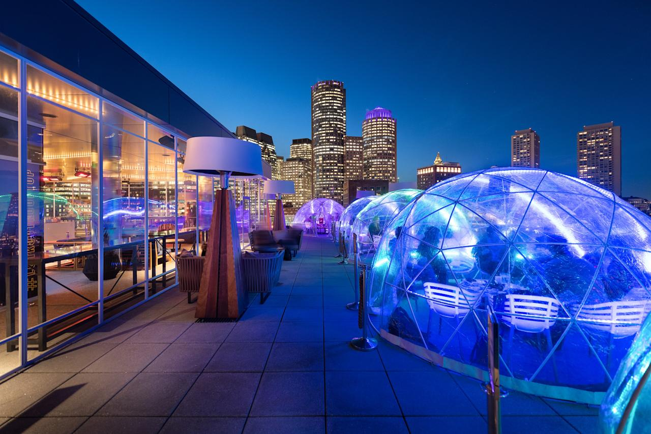 """Boston's premiere rooftop bar, Lookout Rooftop at <a href=""""https://www.cntraveler.com/hotels/united-states/boston/the-envoy-hotel?mbid=synd_yahoo_rss"""">The Envoy Hotel</a>, Boston, is heating things up this winter with the return of its wildly popular insulated igloos and a new heated enclosure of its main bar. Sip on large format cocktails like the Apple Bottom Jeans, a mix of Crop pumpkin vodka, apple butter, and soda; enjoy good conversation in the toasty, domed surrounds; and pop out to appreciate the panoramic views of the snow-capped Boston skyline and icy Boston Harbor."""