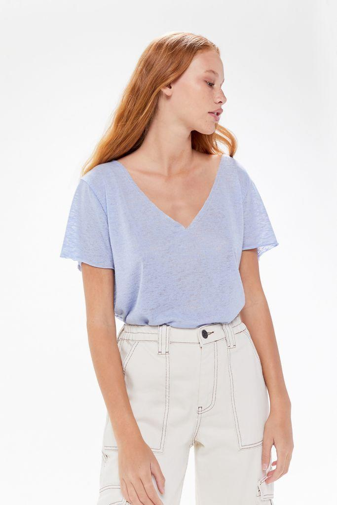 """Make getting """"dressed"""" in the morning easier with this light-as-air tee. $34, Urban Outfitters. <a href=""""https://www.urbanoutfitters.com/shop/project-social-t-textured-knit-v-neck-tee-004"""" rel=""""nofollow noopener"""" target=""""_blank"""" data-ylk=""""slk:Get it now!"""" class=""""link rapid-noclick-resp"""">Get it now!</a>"""