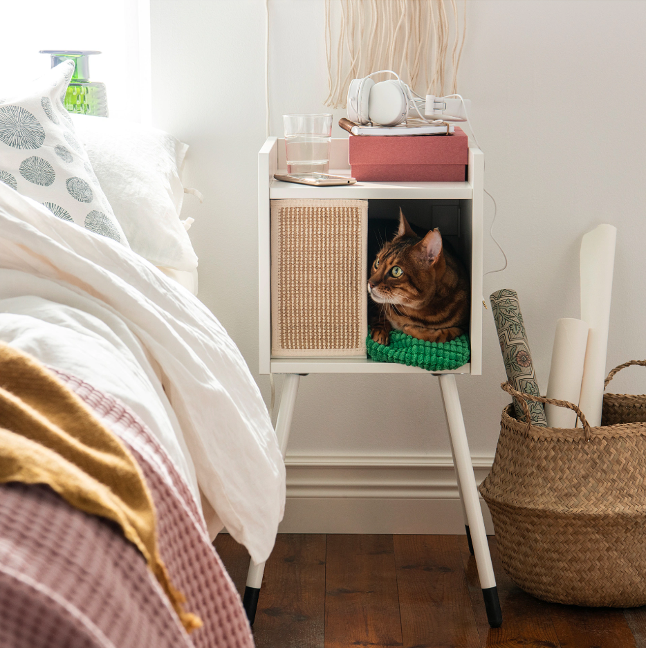 """<p>Put this cat house on the floor by your bed, hang it on a wall, or put it in KALLAX shelving unit. A cozy nook where your cat can rest undisturbed, yet still be close by.</p><p><em>IKEA Lurvig Cat House on Legs in White, $50, </em><a href=""""https://www.ikea.com/us/en/catalog/products/00376545/""""><em>ikea.com</em></a><em>.</em></p>"""