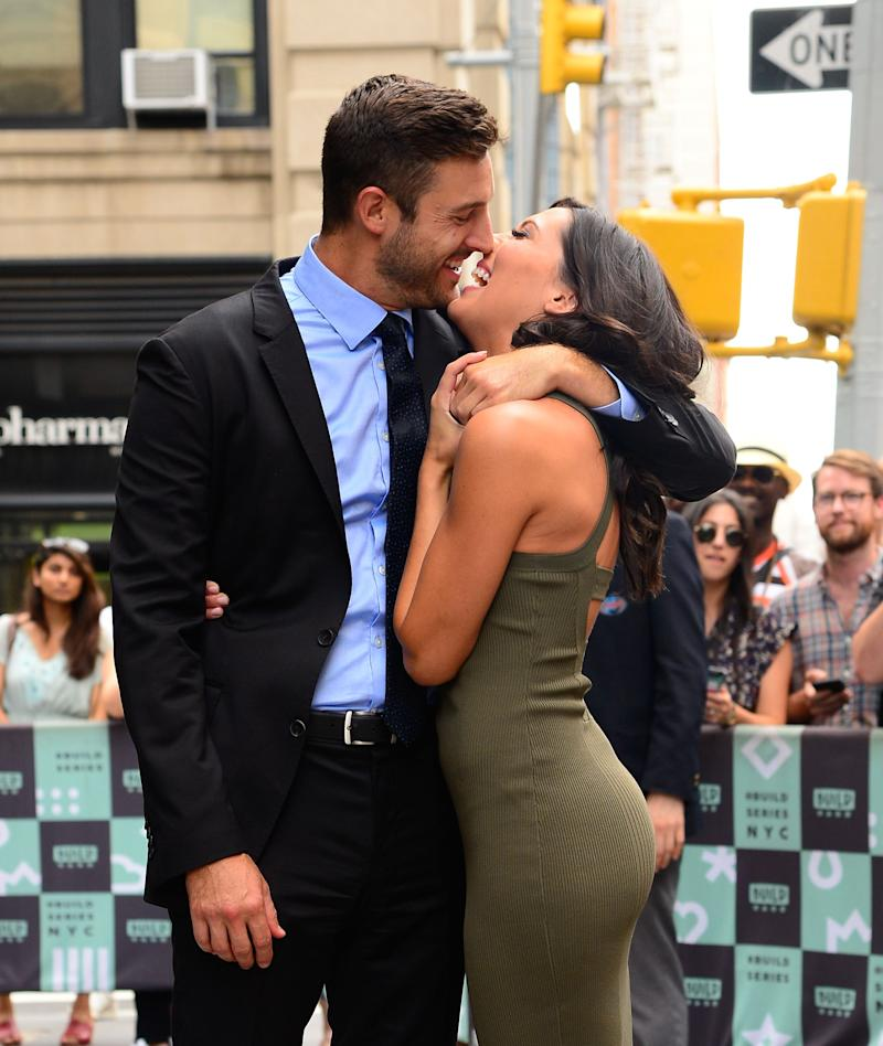 Garret Yrigoyen wraps Becca Kufrin in his arm. The couple is nearly kissing