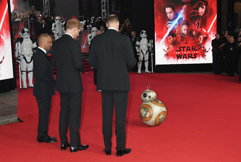 Prince William, Duke of Cambridge, and Prince Harry meet BB-8 at the European Premiere of