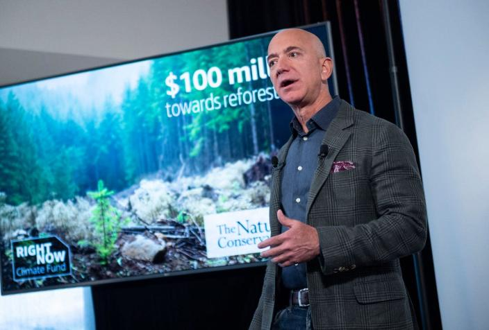 """<span class=""""caption"""">Jeff Bezos is pouring $10 billion into the fight against climate change.</span> <span class=""""attribution""""><a class=""""link rapid-noclick-resp"""" href=""""https://www.gettyimages.com/detail/news-photo/amazon-founder-and-ceo-jeff-bezos-speaks-to-the-media-on-news-photo/1169517997?adppopup=true"""" rel=""""nofollow noopener"""" target=""""_blank"""" data-ylk=""""slk:Eric Baradat/AFP via Getty Images"""">Eric Baradat/AFP via Getty Images</a></span>"""