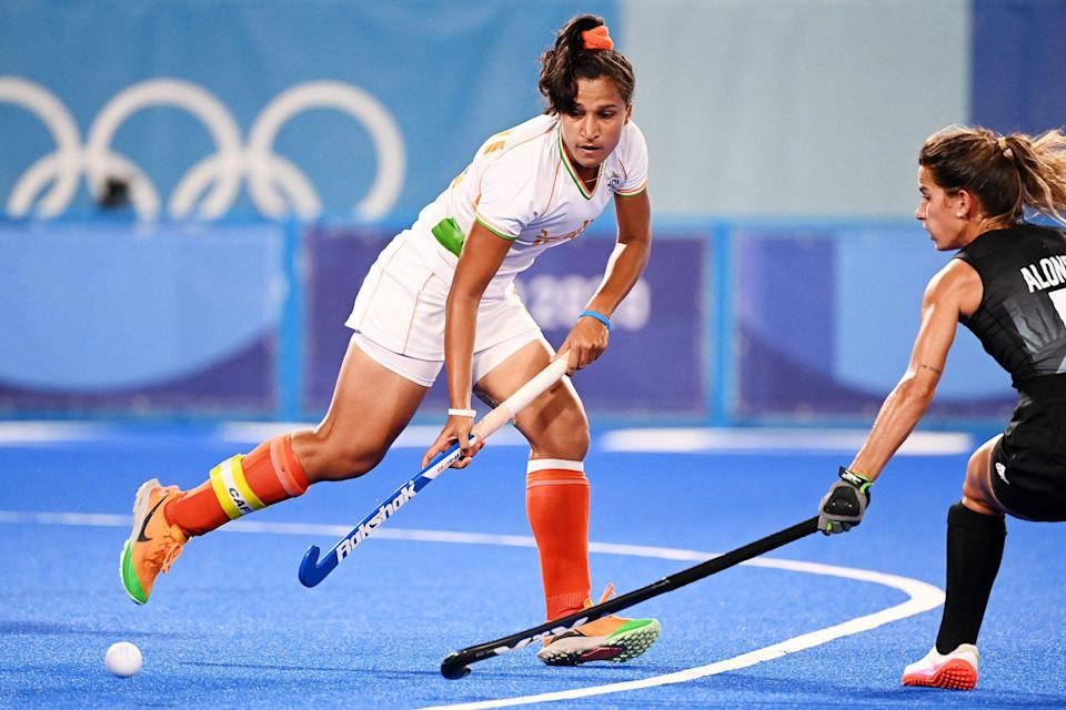 India's Rani (L) is tackled by Argentina's Agostina Alonso during their women's semi-final match of the Tokyo 2020 Olympic Games field hockey competition, at the Oi Hockey Stadium in Tokyo, on August 4, 2021.