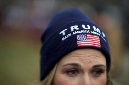 FILE PHOTO: A supporter of President Donald Trump wears a campaign hat during a
