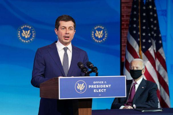 PHOTO: Pete Buttigieg speaks as President-elect Joe Biden looks on after he was nominated to be Secretary of Transportation during a news conference at Biden's transition headquarters on Dec. 16, 2020, in Wilmington, Del. (Kevin Lamarque/POOL via Getty Images, FILE)