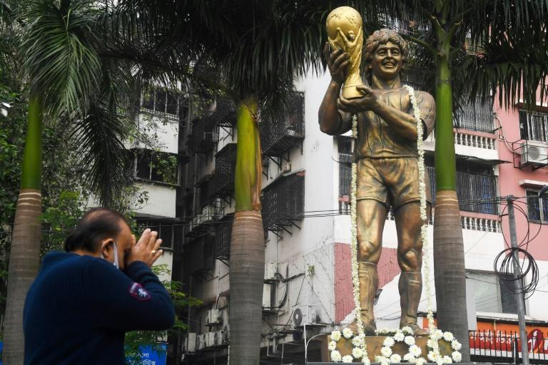 Fans paid homage at a Maradona statue in the Indian city of Kolkata