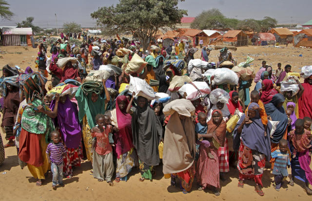 FILE - In this March 30, 2017 file photo, Somalis displaced by a drought arrive at makeshift camps on the outskirts of Mogadishu, Somalia. Britain is hosting a high-level conference on Thursday, May 11, 2017, to address the threat of famine in Somalia. (AP Photo/Farah Abdi Warsameh, File)