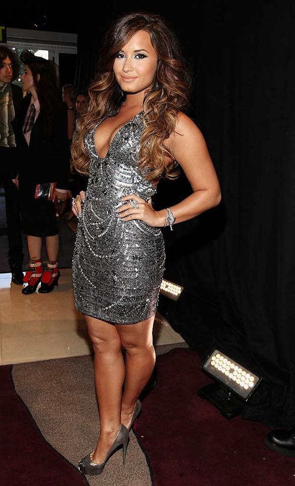 "Va-va-voom! Demi Lovato -- whose new album, <i>Unbroken</i> comes out next month -- showed off her curves in a metallic mini featuring a plunging neckline. Is the dress too daring for a 19-year-old? Christopher Polk/<a href=""http://www.gettyimages.com/"" target=""new"">GettyImages.com</a> - August 28, 2011"