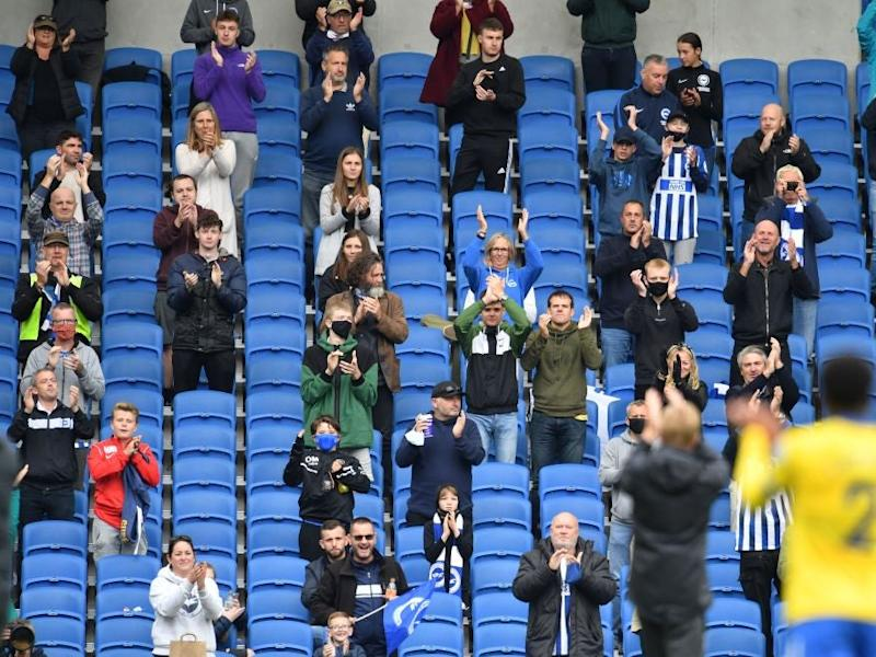 Socially distanced fans at the Brighton vs Chelsea friendly (AFP via Getty)