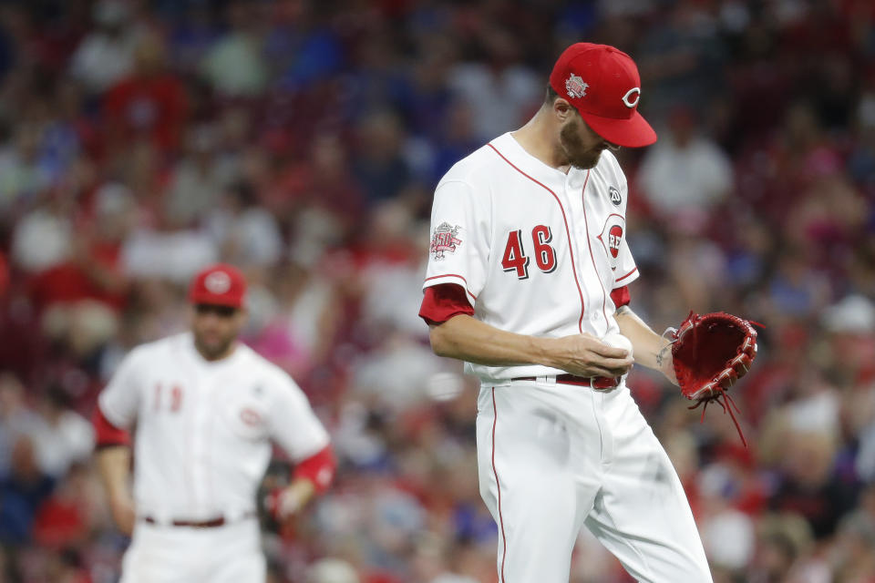Cincinnati Reds relief pitcher Kevin Gausman reacts after giving up a solo home run to Chicago Cubs' Nicholas Castellanos during the fourth inning of a baseball game Thursday, Aug. 8, 2019, in Cincinnati. (AP Photo/John Minchillo)