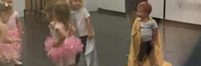 Jameson wearing a gold cape at ballet class.