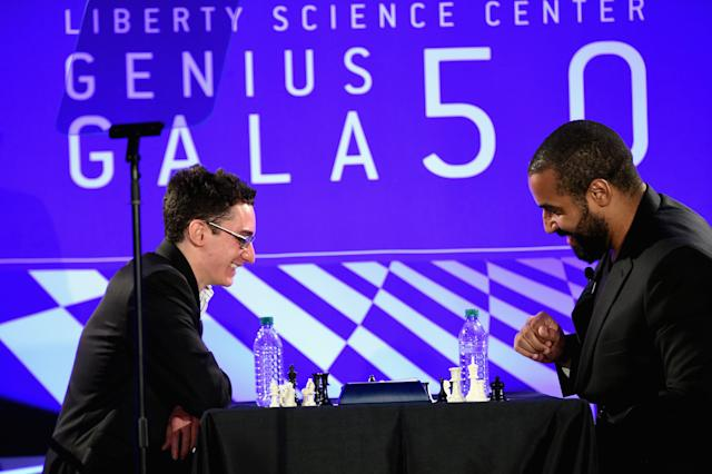 John Urschel faces Grandmaster Fabiano Caruana, one of the top 10 players in the world, at the Liberty Science Center's Genius Gala on May 20, 2016 in Jersey City, New Jersey.