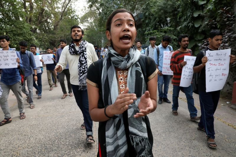 Students shout slogans during a protest against the alleged rape and murder of a 27-year-old woman, in Kolkata