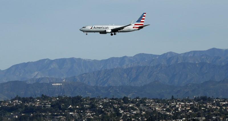 An American Airlines plane is pictured during its approach to Los Angeles International airport in Los Angeles