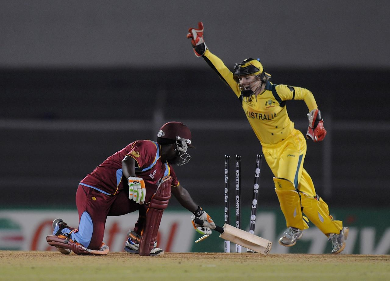 MUMBAI, INDIA - FEBRUARY 17:  Deandra Dottin of West Indies gets bowled out by Lisa Sthalekar of Australia during the final between Australia and West Indies held at the CCI (Cricket Club of India) stadium on February 17, 2013 in Mumbai, India.  (Photo by Pal Pillai/Getty Images)
