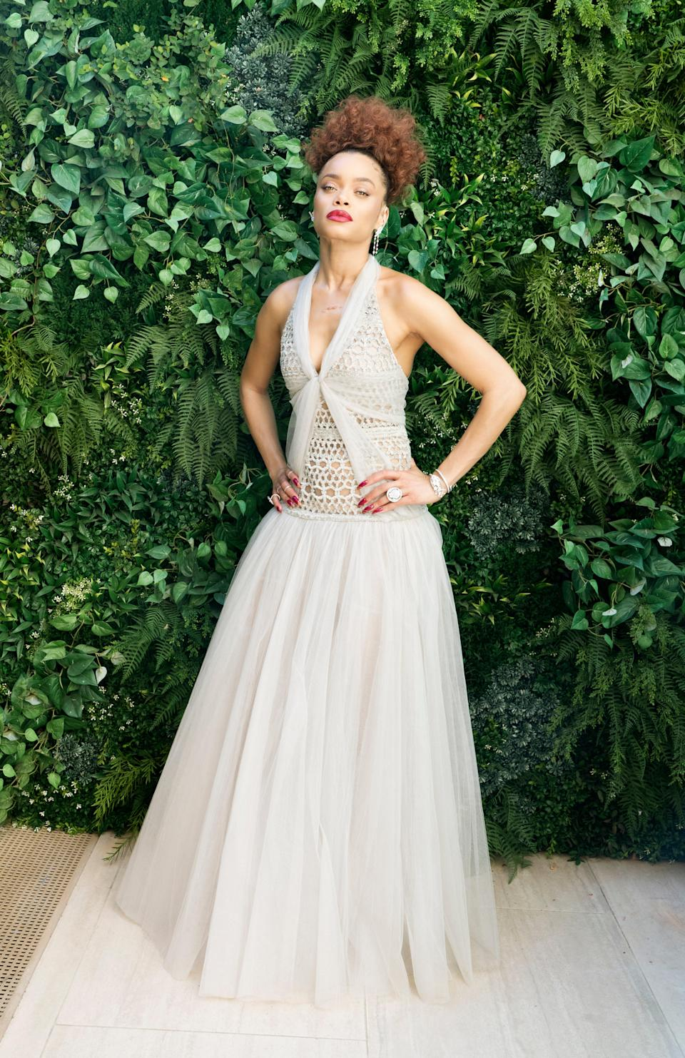"""<h2>Andra Day in Chanel</h2><br>Just like her character in <em><a href=""""https://www.refinery29.com/en-us/2021/02/10330995/united-states-vs-billie-holiday-prada-fashion-black-excellence"""" rel=""""nofollow noopener"""" target=""""_blank"""" data-ylk=""""slk:The United States vs. Billie Holiday"""" class=""""link rapid-noclick-resp"""">The United States vs. Billie Holiday</a></em>, Andra Day was the epitome of glamour at the Golden Globes, wearing a light gray, crochet gown by Chanel.<span class=""""copyright"""">Photo Credit: Myriam Santos.</span>"""