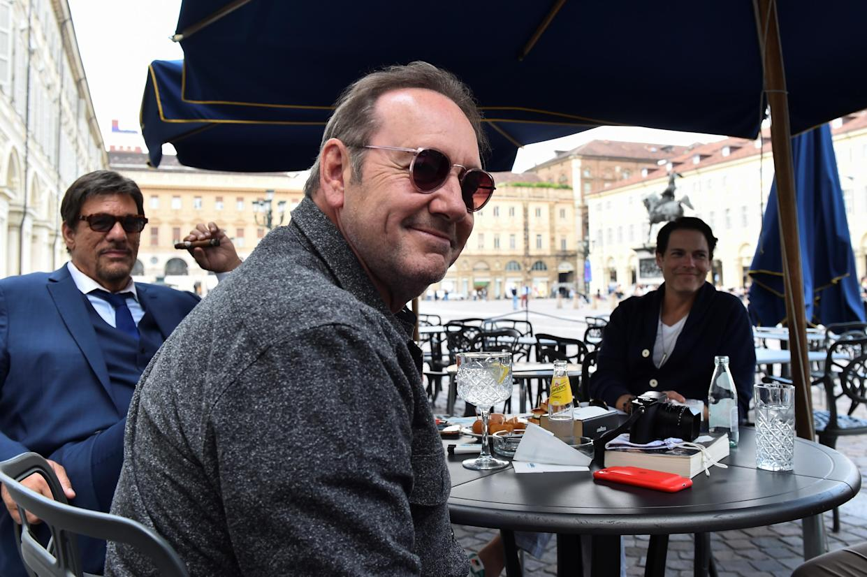 Actor Kevin Spacey sits at a caffe in Piazza San Carlo as he visits the city, where he is expected to return for a cameo appearance in a low budget Italian film, after largely disappearing from public view, in Turin, Italy, June 1, 2021. REUTERS/Massimo Pinca