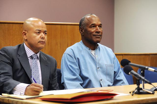 <p>O.J. Simpson (R) arrives for his parole hearing with attorney Malcolm LaVergne at Lovelock Correctional Centre in Lovelock, Nevada, U.S. July 20, 2017. REUTERS/Jason Bean/POOL </p>
