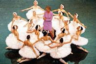 <p>The scene of Kate in her fuchsia skirt suit was reminiscent of this photo of Princess Diana surrounded by ballerinas at the English National Ballet's 1997 production of Swan Lake.</p>