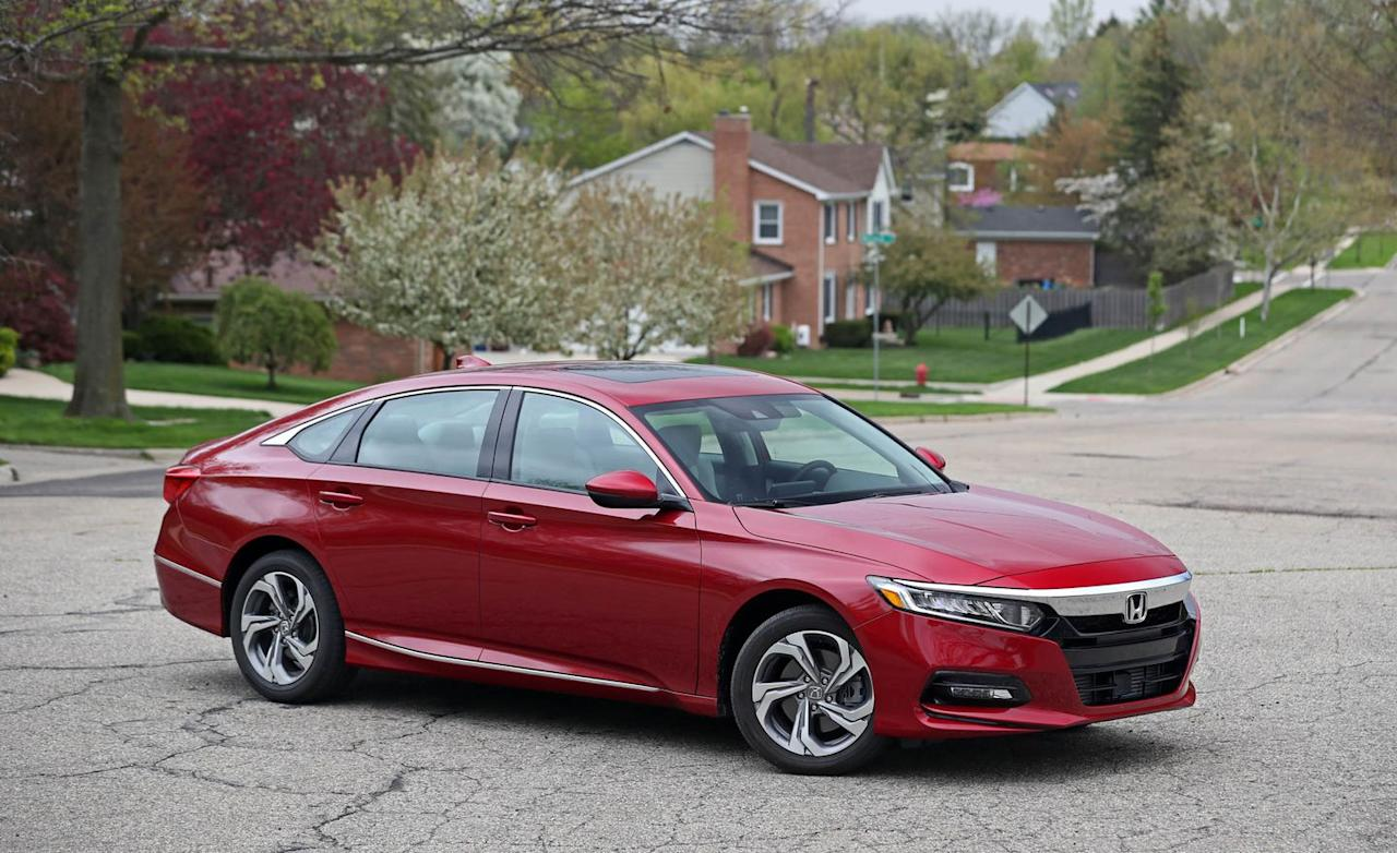 "<p>Why do we love the <a rel=""nofollow"" href=""https://www.caranddriver.com/honda/accord"">Accord</a>? Let us count the ways. This 33-time 10Best winner shows great attention to the details and does everything well. It's roomy, efficient, lively, and fun to drive while at the same time being quite refined. It's solidly built. Its interior is handsomely designed. The base 192-hp turbocharged inline-four-cylinder engine is peppy, and we love that you can get the Accord with a manual transmission. Honda's suite of active safety gear is standard. The Accord is priced right, too. In fact, our preferred model, the Accord Sport, adds visual spice and fatter, lower-profile tires and still comes in at a very reasonable $27,100. </p>"