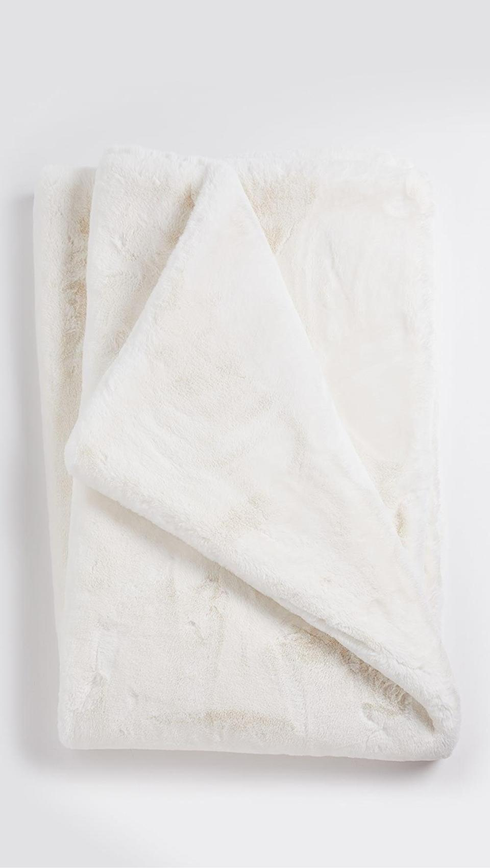 <p>Keep them cozy in this chic <span>Apparis Shirley Blanket</span> ($250).</p>