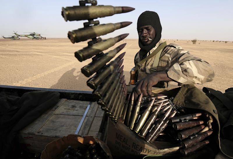A Malian soldier handles ammunitions aboard a vehicle as they enter Bourem, northern Mali, Sunday, Feb. 17, 2013. Mali's military detained eight Arab men last week in Timbuktu, raising fears of further reprisals against the region's Arab minority whose members are accused of having supported the al-Qaida-linked groups which overran northern Mali last year. (AP Photo /Pascal Guyot, Pool)