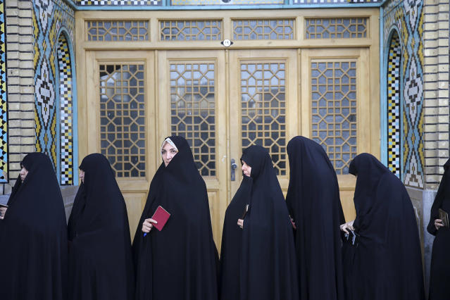 <p>Female voters queue at a polling station for the presidential and municipal council election in the city of Qom, 78 miles (125 kilometers) south of the capital Tehran, Iran, May 19, 2017. Iranians began voting Friday in the country's first presidential election since its nuclear deal with world powers, as incumbent Hassan Rouhani faced a staunch challenge from a hard-line opponent over his outreach to the wider world. (Photo: Ebrahim Noroozi/AP) </p>