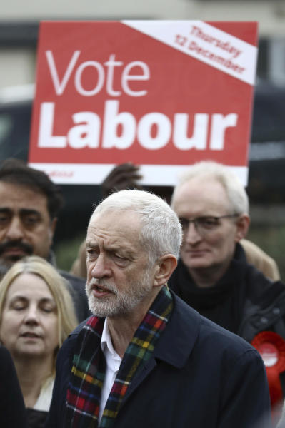 Britain's opposition Labour Party leader Jeremy Corbyn, speaks to supporters, while holding his party's manifesto, during a General Election campaign visit to Thurrock, England, Sunday Nov. 24, 2019.  Britain's Brexit is one of the main issues for political parties and for voters, as the UK goes to the polls in a General Election on Dec. 12. (Aaron Chown/PA via AP)