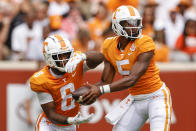 Tennessee quarterback Hendon Hooker (5) hands the ball off to running back Tiyon Evans (8) during the first half of an NCAA college football game against Tennessee Tech, Saturday, Sept. 18, 2021, in Knoxville, Tenn. (AP Photo/Wade Payne)