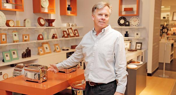 J.C. Penney CEO Ron Johnson shows of a bread-shaped Michael Graves toaster at a Penney location in Dallas, Texas, on February 5, 2013. (Michael Ainsworth/Dallas Morning News/MCT)