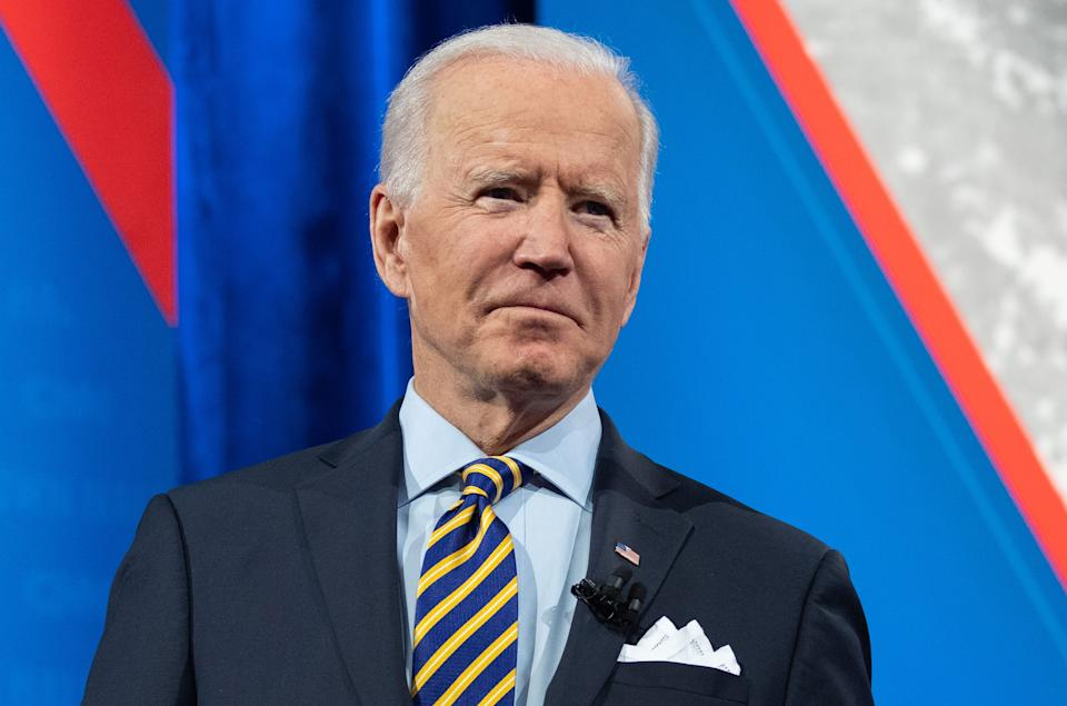 US President Joe Biden holds a face mask as he participates in a CNN town hall at the Pabst Theater in Milwaukee, Wisconsin, February 16, 2021. (Photo by SAUL LOEB / AFP) (Photo by SAUL LOEB/AFP via Getty Images)
