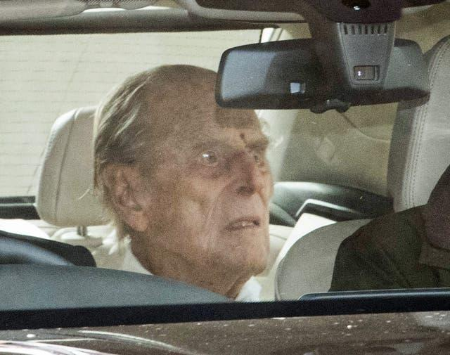 The Duke of Edinburgh is driven away in a car after leaving the King Edward VII's Hospital, London
