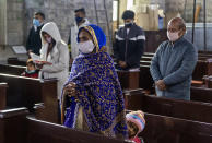 Indian Christians, who are registered members of St. John in the Wilderness church, maintain social distancing as they attend the Christmas mass in Dharmsala, India, Friday, Dec. 25, 2020. The church which was built in 1852, is currently closed to general visitors due to COVID-19 restrictions. (AP Photo/Ashwini Bhatia)