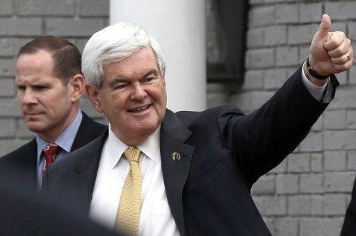 Republican presidential candidate Newt Gingrich gives a thumbs up sign to supporters after speaking in Birmingham, Alabama. Gingrich, speaking to Fox News earlier Tuesday, dismissed Romney as the candidate of corporate fat cats and touted his plan to bring down the price of gas to $2.50 from around $4 currently