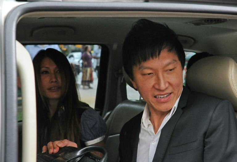 Singapore prosecutors are seeking a review of a court ruling which slashed the jail term of a showbiz pastor Kong Hee (R) who misused millions in church funds to promote his wife Ho Yeow Sun (L)'s music career, amid public outcry