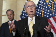 Senate Minority Leader Mitch McConnell of Ky., right, speaks to the media next to Sen. John Thune, R-S.D., Tuesday, May 18, 2021, after a meeting with Senate Republicans on Capitol Hill in Washington. (AP Photo/Jacquelyn Martin)