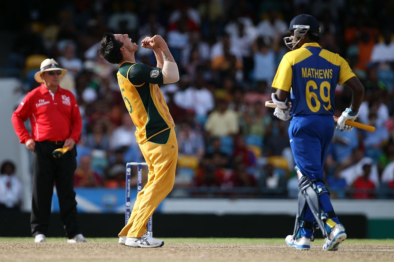 BRIDGETOWN, BARBADOS - MAY 09:  Mitchell Johnson of Australia celebrates the wicket of Angelo Mathews of Sri Lanka during the ICC World Twenty20 Super Eight match between Sri Lanka and Australia at the Kensington Oval on May 9, 2010 in Bridgetown, Barbados.  (Photo by Clive Rose/Getty Images)