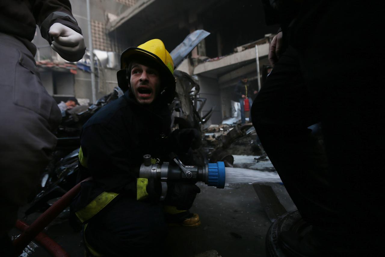 Firefighters attempt to extinguish a fire following an explosion in Beirut's southern suburbs, January 2, 2014.A powerful explosion struck southern Beirut on Thursday, a stronghold of the Shi'ite group Hezbollah, killing at least two people and sending a column of smoke into the sky, a witness said.  REUTERS/Hasan Shaaban (LEBANON - Tags: POLITICS CIVIL UNREST)
