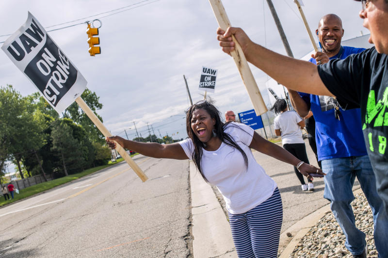 Flint resident Dorrit Madison, who has worked at the plant for more than 11 years, shouts out at cars passing by as General Motors employees demonstrate outside of the Flint Assembly Plant on Sunday, Sept. 15, 2019 in Flint. GM autoworkers in Lansing officially go on strike at midnight Sunday after UAW leadership voted to do so Sunday morning. (Jake May/The Flint Journal via AP)