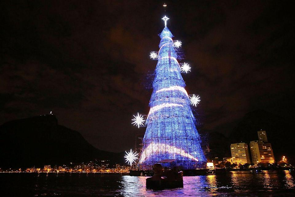 """<p>Brazil is home to the world's largest floating <a href=""""https://www.housebeautiful.com/entertaining/holidays-celebrations/tips/g505/christmas-tree-decoration-ideas-pictures-1208/"""" rel=""""nofollow noopener"""" target=""""_blank"""" data-ylk=""""slk:Christmas tree"""" class=""""link rapid-noclick-resp"""">Christmas tree</a>. The tree is 85 meters tall and features over three million light bulbs.</p>"""