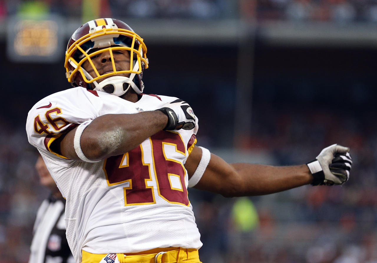 Washington Redskins running back Alfred Morris celebrates after scoring on a 3-yard touchdown run against the Cleveland Browns in the third quarter of an NFL football game in Cleveland, Sunday, Dec. 16, 2012. (AP Photo/Rick Osentoski)