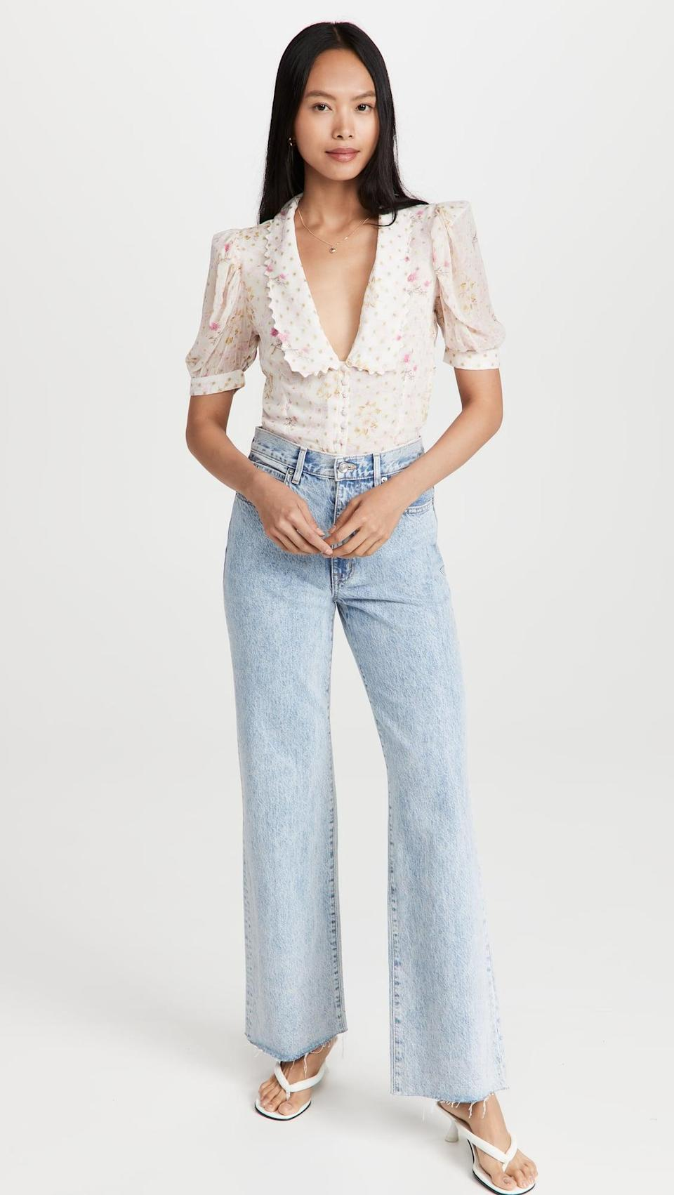 <p>If you're constantly thinking about how to effectively tuck a blouse into your jeans, worry no more. This <span>Hemant and Nandita Exaggerated Collar Thong Bodysuit</span> ($183) is seamless and so easy to style.</p>