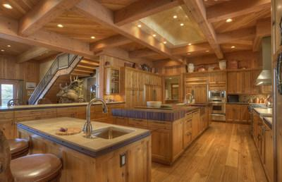 Designed in the style of the most exclusive luxury mountain resorts, the home boasts impeccable construction and interiors with fine finishes like reclaimed Douglas fir. The gourmet kitchen (shown here) includes top-of-the-line appliances, several prep sinks, and an immense kitchen island with wooden butcher block tops. DurangoLuxuryAuction.com.
