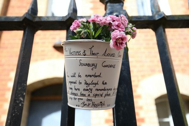 Flowers and a message left at the Abbey gateway of Forbury Gardens