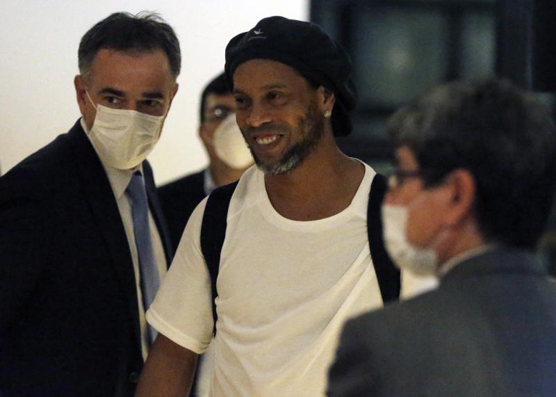Former Brazilian soccer star Ronaldinho arrives at a hotel where he is to stay under house arrest in Asuncion, Paraguay, Tuesday, April 7, 2020. Ronaldinho and his brother Roberto De Assis Moreira spent a month in jail accused of entering Paraguay with fake passports. (AP Photo/Jorge Saenz)