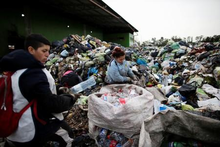 Waste pickers sift through trash in the neighborhood of Jose Leon Suarez, on the outskirts of Buenos Aires